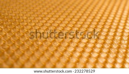 Golden honeycomb background, beeswax frame, hexagonal pattern - stock photo