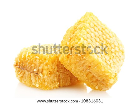 golden honeycombs isolated on white