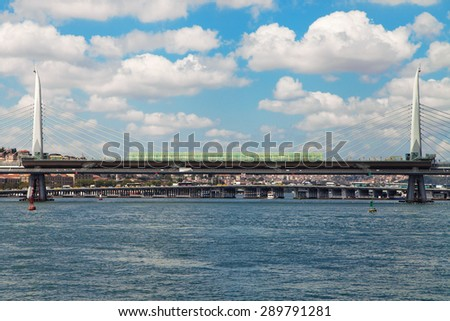 Golden Horn Metro Bridge with the Ataturk Bridge in the background, Istanbul, Turkey. - stock photo
