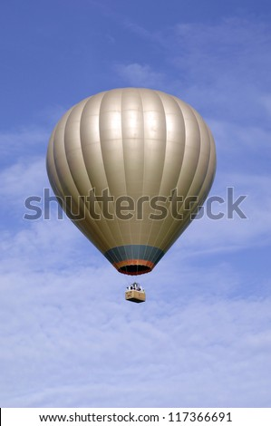 Golden Hot air balloon in blue sky