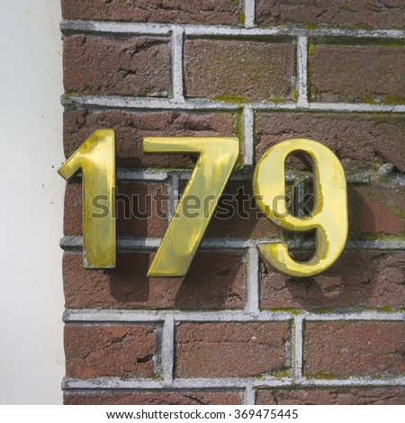 Golden house number one hundred and seventy nine. - stock photo