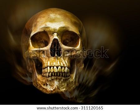 Golden human skull on motion blur and dark background - stock photo