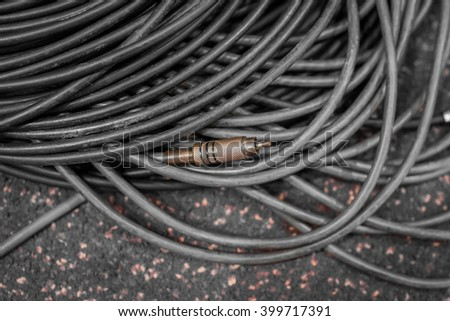 Golden jack plug of audio cable - stock photo