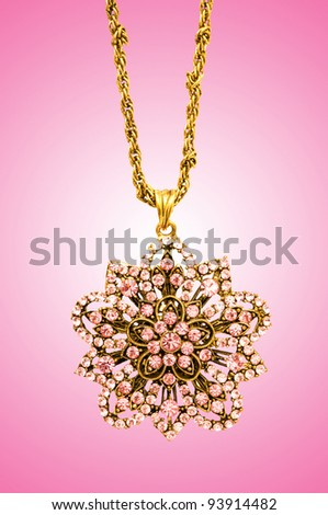 Golden jewellery against gradient background - stock photo