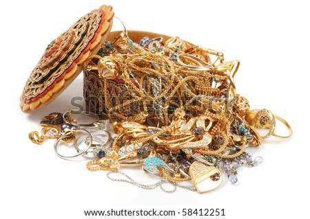 Golden jewelry in open box on white background - stock photo