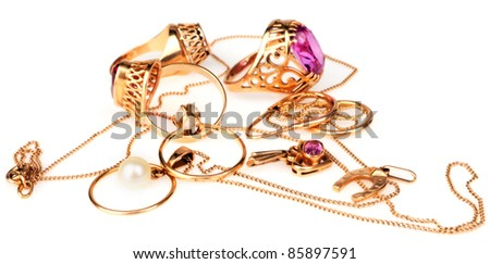 Golden jewelry over white background, selective focus - stock photo