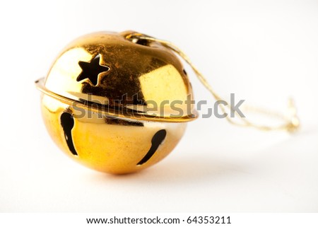 Golden jingle bell Christmas bauble on white - stock photo