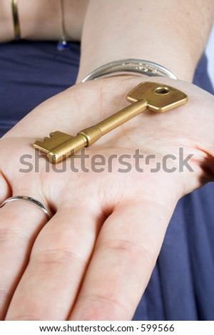 golden key on a hand