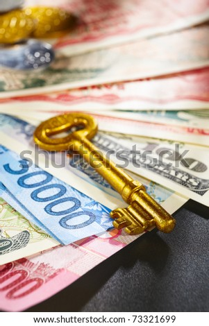 Golden key over money from different countries