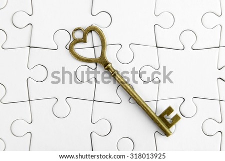 Golden Key to the puzzle  - stock photo