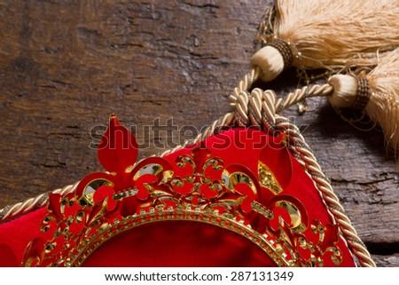 Golden king's crown and scepter on red velvet - stock photo
