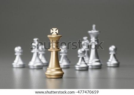 Golden King with silver king, rook, pawn on the background