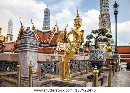 Golden Kinnara Statue at Emerald Buddha Temple in Grand Palace, Bangkok - stock photo
