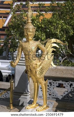 Golden Kinnaree (half woman - half bird) figure at Wat Prakaew, Thailand's ancient royal temple and palace. - stock photo