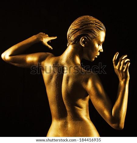 Golden lady - stock photo