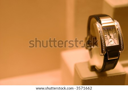 Golden lady watch with brilliants - stock photo