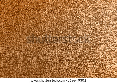 Golden leather texture close up - stock photo
