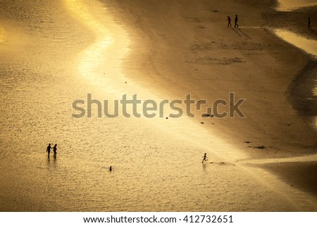 golden light at tropical Chao Laow beach in Chanthaburi province east of Thailand - stock photo