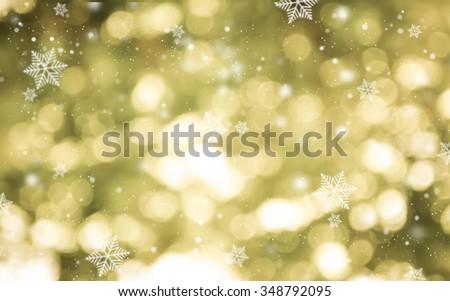 Golden light bokeh and snowflake Christmas Background. - stock photo