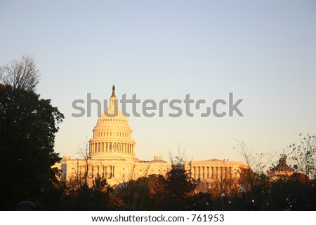 golden light near sunset; us capitol in autumn/early winter