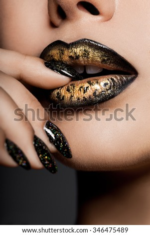 golden lips with beautiful decor - stock photo