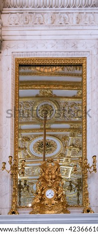 Golden luxury vintage clock in Winter Palace at St. Petersburg, Russia - stock photo