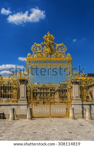 Golden Main Gates of the Versailles Palace. The Palace Versailles was a royal chateau. It was added to the UNESCO list of World Heritage Sites. Paris, France. - stock photo