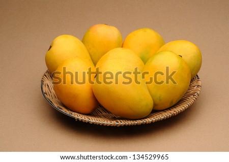 golden mango in a basket - stock photo