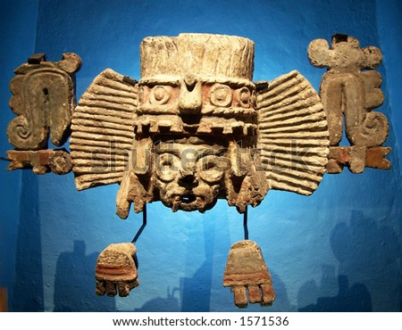 Golden mask in museum of Tenochtitlan. - stock photo