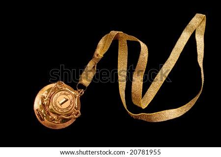 Golden medal on black ground - stock photo