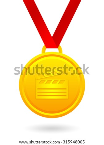 Golden medal with clapper board - stock photo
