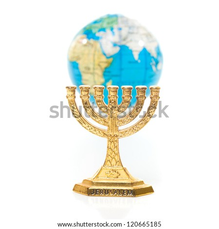 Golden Menorah and globe in small DOF isolated on white background - stock photo