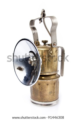golden mining lamp on a white background - stock photo