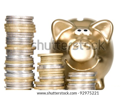 Golden money box pig standing on coins