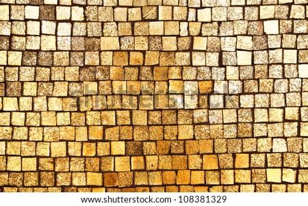 Golden mosaic wall background texture - stock photo