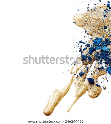 Golden nail polish and blue eye shadow isolated on white background - stock photo