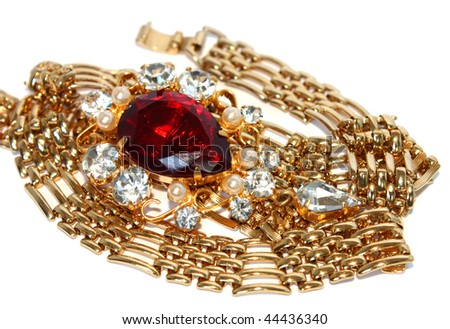 golden necklace and vintage brooch isolated - stock photo