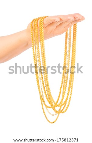 golden necklace in left hand isolated on white - stock photo