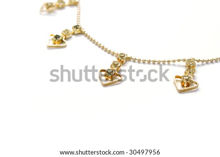 Golden necklace with hearts and stones.