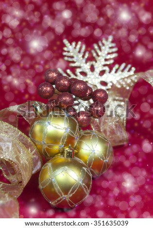 golden New Year's balls and ribbon - stock photo