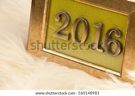Golden numbers 2016 in a vintage picture frame, the New Year's theme  - stock photo