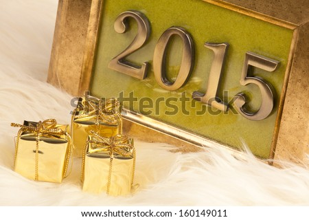 Golden numbers 2015 in a vintage picture frame, the New Year's theme  - stock photo
