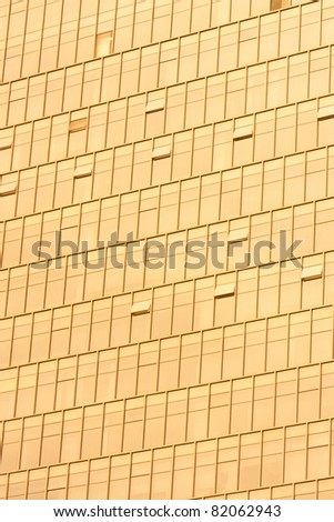 Golden Office building glass wall - stock photo