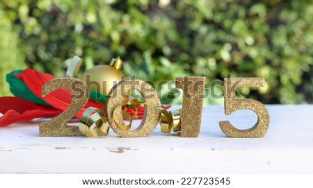 golden 2015 on table with decoration in garden  - stock photo