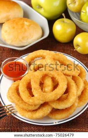 Golden onion rings and ketchup - stock photo