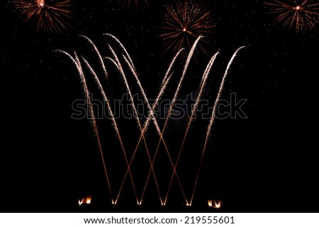 Golden orange amazing fireworks isolated in dark background close up with the place for text, Malta fireworks festival, 4 of July, Independence day, New Year, explode, Vilnius festival, cropped photo - stock photo