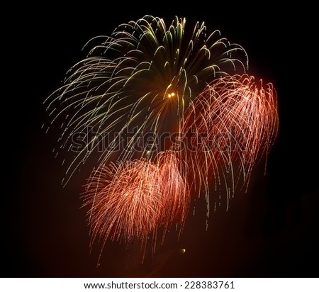 Golden orange amazing fireworks isolated in dark background close up with the place for text, Malta fireworks festival, 4 of July, Independence day, New Year, explode, square photo fireworks festival - stock photo