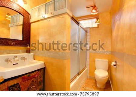 Golden orange bathroom with old world style. - stock photo