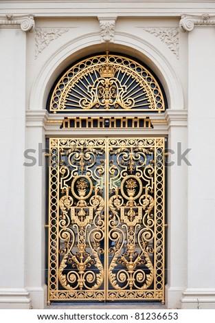 Golden ornate door - stock photo