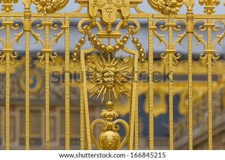 Golden ornate gate of Chateau de Versailles Paris, France, Europe. - stock photo